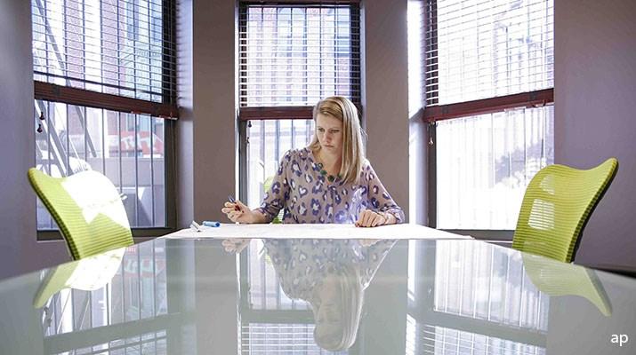 Woman in a boardroom